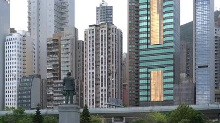 memorial day : Hong Kong, Sun Yat Sen statue in Sai Ying Pun watches Hong Kong Island