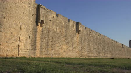 Panning shot of the walls of the fortress of Aigues Mortes in southern France