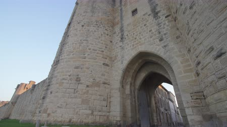 Gate of the fortress of Aigues Mortes in southern France - panning shot
