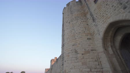 swamps : Gate of the fortress of Aigues Mortes in southern France - tilt Stock Footage