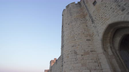 Gate of the fortress of Aigues Mortes in southern France - tilt Stock Footage