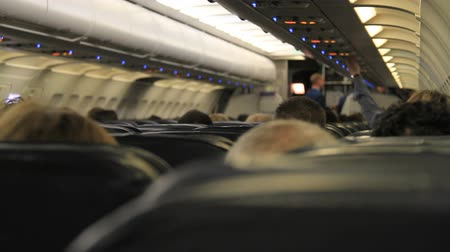 steward : Passengers seated on the plane