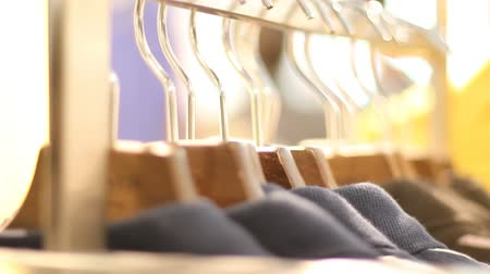 покупка товаров : Clothes on hangers in close-up