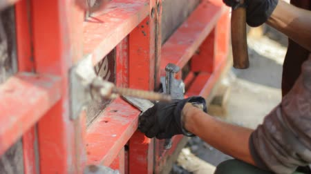 metal worker : Worker hammers construction nail