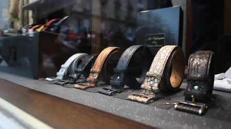дорогой : Male belts in boutique shop Стоковые видеозаписи