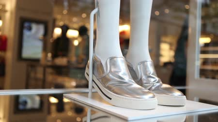 ayakkabı : Silver sneakers on store display