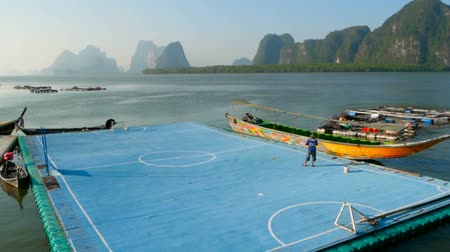sziámi : A view of the floating football field in a fishing village Koh Panyee.