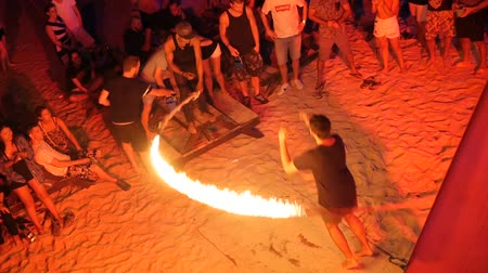 fullmoon : PHANGAN, THAILAND - 31TH March, 2018: Haadrin fullmoon beach party. Young teens have fun on the tropical island. Boys ang girls enjoy fire rope jumping competition. Students have vacation in paradise.