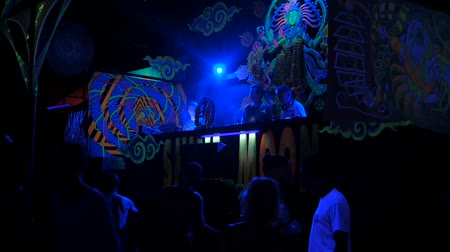 festett : PHANGAN, THAILAND - MARCH 16, 2018: Shiva Moon Goa Trance Party. Psychedelic neon and luminescent decoration of dance floor and dj stage. Young people have fun on the tropical event.