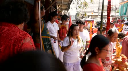gong : SAMUI, THAILAND - FEBRUARY 24, 2018: Thai Chinese worshipers and devotees take part in Chinese new year festival procession with elements of self-harming,religious rituals, mediums, oracles, priests.