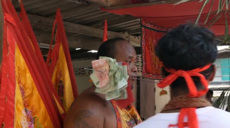 creed : SAMUI, THAILAND - FEBRUARY 24, 2018: Thai Chinese worshipers and devotees take part in Chinese new year festival procession with elements of self-harming,religious rituals, mediums, oracles, priests.