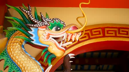 cny : Religious colorful sculpture of Dragon. Shrine in chinese traditional style decorated with ornaments. Art architecture, buddhist artwork spectacular temple in Thailand. A holy animal in east culture.