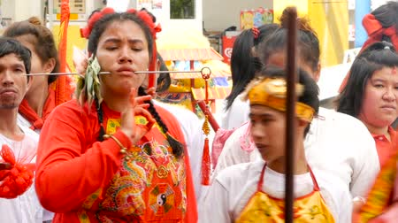 ferida : SAMUI, THAILAND - FEBRUARY 24, 2018: Thai Chinese worshipers and devotees take part in Chinese new year festival procession with elements of self-harming,religious rituals, mediums, oracles, priests.