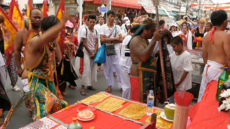 taoism : SAMUI, THAILAND - FEBRUARY 24, 2018: Thai Chinese worshipers and devotees take part in Chinese new year festival procession with elements of self-harming,religious rituals, mediums, oracles, priests.