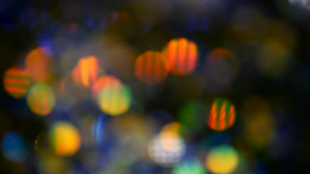 мишура : Defocused shimmering multicolored glitter confetti, black background. Party, magic, imagination. Rainbow colors, sparkle circles. Holiday abstract festive texture of shiny blurred bokeh light spots. Стоковые видеозаписи
