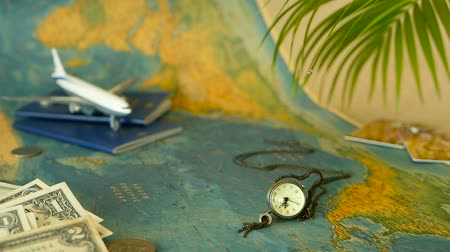 travel theme : Time to travel concept. Tropical vacation theme with world map, blue passport and plane. Preparing for holliday, journey. Trip items with copy space. North America on the world map. Tourism background