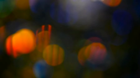 jiskry : Defocused shimmering multicolored glitter confetti, black background. Party, magic, imagination. Rainbow colors, sparkle circles. Holiday abstract festive texture of shiny blurred bokeh light spots. Dostupné videozáznamy
