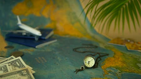 weekendje weg : Time to travel concept. Tropical vacation theme with world map, blue passport and plane. Preparing for holliday, journey. Trip items with copy space. North America on the world map. Tourism background
