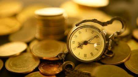зарабатывать : Management efficiency, time is money. Vintage pocket watch with golden coins stack on black background. Time for Success of Finance Business. Investment, business financial ideas concept Стоковые видеозаписи