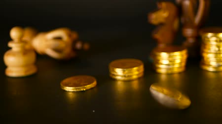 wealth : Chess and stack of coins in concept of money power or saving money, financial growth, strategy investment, retirement planning, business finance wealth and success. Rotating, twisting, swirling penny Stock Footage