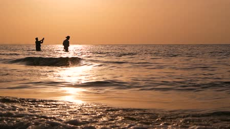 çubuk : Fisherman silhouette in action when spinning on sunset time. Traditional Asian occupation and way of obtaining food.