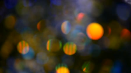 dazzle : Defocused shimmering multicolored glitter confetti, black background. Party, magic, imagination. Rainbow colors, sparkle circles. Holiday abstract festive texture of shiny blurred bokeh light spots. Stock Footage