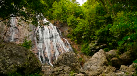 maravilhoso : Jungle paradise landscape of tropical country. Waterfall cascade in green rain forest. Motion of water flow from cliff down. Exotic river and rocks. Natural seasonal travel outdoor background
