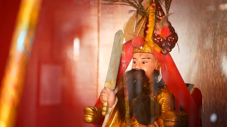 religioso : Buddhist traditional statues of chinese sacred gods on the altar inside the temple Stock Footage