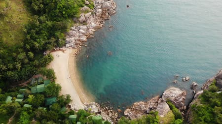 sail rock : Aerial drone top view of white sand tropical exotic paradise tiny shore in Koh Prangan island, Thailand. Small boats on ocean surface. Cute remote beach with volcanic stones and green coconut palms. Stock Footage