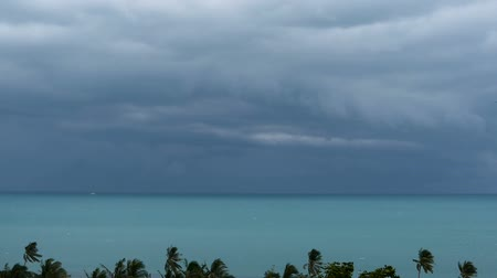 Тропический климат : Dramatic gloomy sky with dark thunderstorm clouds over turquoise sea. Hurricane on ocean horizon. Vivid aerial timelapse beautiful view of storm raining seascape. Tropical rain season, typhoon weather Стоковые видеозаписи