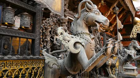 patan : Ancient bronze and brass mythological sculptures and artifacts, Rudra Varna Mahavihar, unique golden buddhist temple in Lalitpur (Patan).  Tibetan buddhism. Durbar Square, Nepal. Stock Footage
