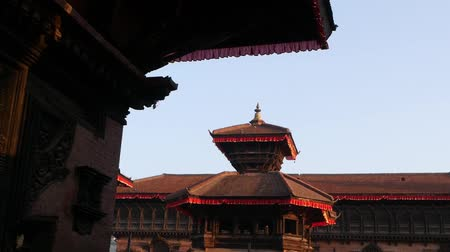 patan : Beautiful old architecture of royal Durbar square. Exterior of temple buildings on Durbar square in bright sunlight under blue sky. oriental ancient city after earthquake.
