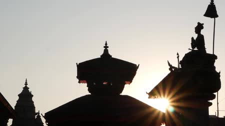 cotidiano : Durbar square in bright sunlight. Silhouettes of oriental buildings and temples on royal Durbar square in oriental ancient old city Bhaktapur, Nepal Stock Footage