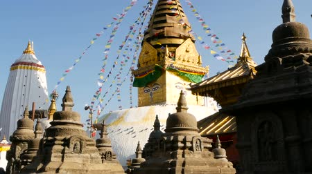 Тибет : Prayer flags flying in the wind, Swayambhunath Stupa, Monkey temple, Holy Pagoda, symbol of Nepal and Kathmandu, Buddhas Eyes. tibetan buddhism, ancient religious architecture