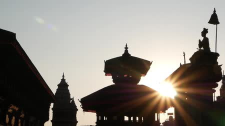 patan : Durbar square in bright sunlight. Silhouettes of oriental buildings and temples on royal Durbar square in oriental ancient old city Bhaktapur, Nepal Stock Footage