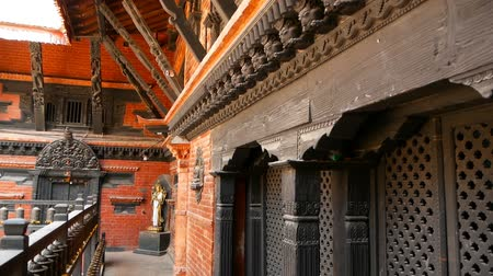 patan : Ancient bronze and brass decorated temple, Rudra Varna Mahavihar, unique buddhist shrine with plenty of prayer wheels in Lalitpur (Patan). Tibetan buddhism. Durbar Square, Nepal.