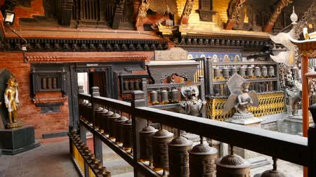 patan : Ancient bronze and brass decorated temple, Rudra Varna Mahavihar, unique buddhist shrine with plenty of prayer wheels in Lalitpur (Patan). World heritage site. Tibetan buddhism. Durbar Square, Nepal.