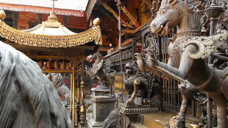 statuette : Ancient bronze and brass mythological sculptures and artifacts, Rudra Varna Mahavihar, unique golden buddhist temple in Lalitpur (Patan). World heritage site. Tibetan buddhism. Durbar Square, Nepal.
