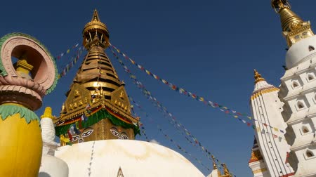 Тибет : Prayer flags flying in the wind, Swayambhunath Stupa, Monkey temple, Holy Pagoda, symbol of Nepal and Kathmandu, Buddhas Eyes. World heritage site. tibetan buddhism, ancient religious architecture