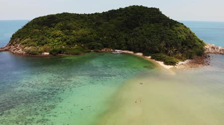 sandy : Aerial drone view small Koh Ma island, Ko Phangan Thailand. Exotic coast panoramic landscape, Mae Haad beach, summer day. Sandy path between corals. Vivid seascape, mountain coconut palms from above Stock Footage