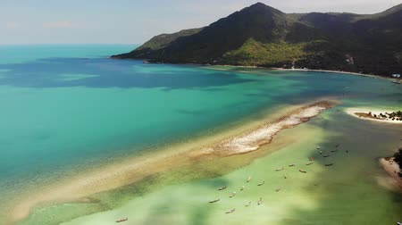 trópicos : Aerial drone view island Koh Phangan Thailand. Exotic coast panoramic landscape, Chaloklum Malibu fisherman beach, summer day. Sandy path, corals. Vivid seascape, mountain coconut palms from above