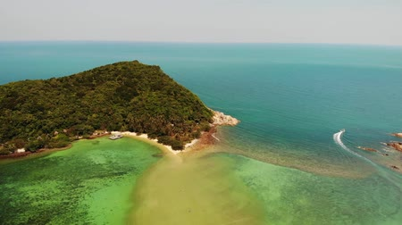 Aerial drone view small Koh Ma island, Ko Phangan Thailand. Exotic coast panoramic landscape, Mae Haad beach, summer day. Sandy path between corals. Vivid seascape, mountain coconut palms from above Stock mozgókép