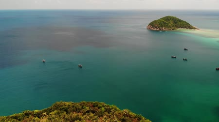 tyrkysový : Aerial drone view small Koh Ma island, Ko Phangan Thailand. Exotic coast panoramic landscape, Mae Haad beach, summer day. Sandy path between corals. Vivid seascape, mountain coconut palms from above.