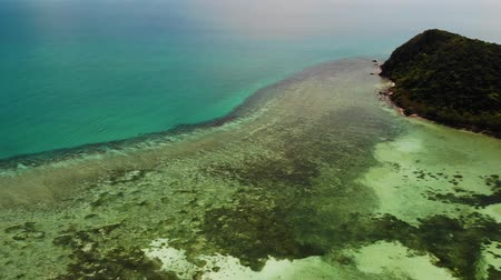 velkolepý : View of amazing coral reefs. Picturesque drone view of tranquil blue sea and beautiful coral reefs near coast of tropical island. Paradise atoll.