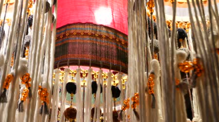 Ornamental oriental lanterns illuminating room. Beautiful traditional oriental lamps made of ornamental fabric shining in room Stockvideo