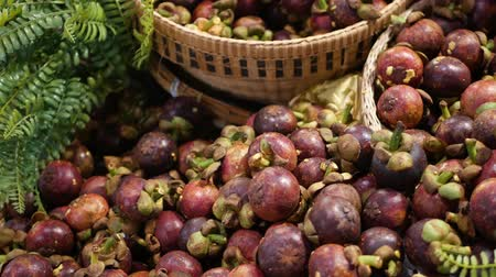 mangosteen : Fruits and vegetables on rustic stall. Assorted fresh ripe fruits and vegetables placed on rustic oriental stall in market. sweet tropical purple mangosteen. Queen of fruits in Thailand.