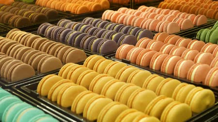 Trays with colorful macaroons. Metal trays with delicious colorful macaroons placed on stall in cafe.