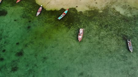 awesome : Fishing boats near reef. Beautiful aerial view of fishing boats floating on blue sea water near majestic coral reef. Natural exotic paradise background. Koh Phangan Samui, Thailand