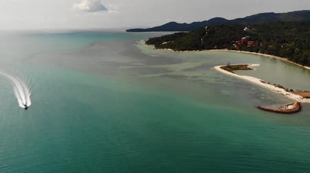 armoni : Blue sea near beaches of tropical island. Breathtaking drone view of calm blue sea near tourist beaches of tropical exotic paradise Ko Phangan Island. Thailand