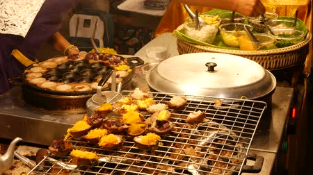exotic dishes : Exotic Oriental Asian sweet delicious desserts, unusual colorful traditional dishes on the counters of a bazar with street food. Evening food court in bangkok, the capital of cooking. Night market.